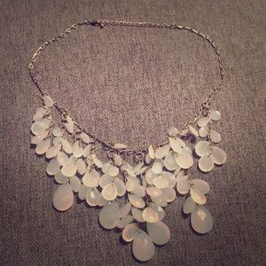 Necklace that dangles with opaque teardrops